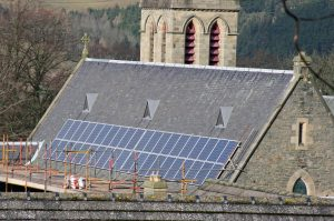 solar panels installed on a church roof with scaffolding.